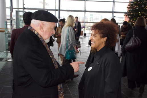 Dr Yvonne Howard-Bunt receiving the Flower of Srebrenica from Former Grand Mufti of Bosnia Herzegovina, Dr Mustafa Cerić, at the Senedd in Cardiff (2017).
